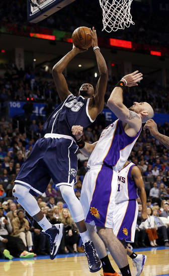 Oklahoma City Thunder's Kevin Durant (35) shoots an off balance in front of Phoenix Suns' Marcin Gortat (4) and scores as the Oklahoma City Thunder play the Phoenix Suns in NBA basketball at the Chesapeake Energy Arena in Oklahoma City, on Monday, Dec. 31, 2012.  Photo by Steve Sisney, The Oklahoman