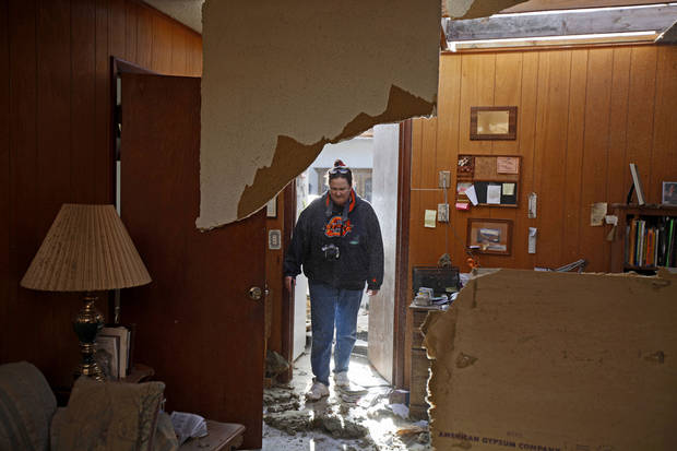 Pam Nelson stands inside the home of her mother-in-law Wilma Nelson in Woodward, Okla., Sunday, April 15, 2012. Wilma Nelson also survived a tornado in Woodward in 1947. A tornado that killed five people struck Woodward, Okla., shortly after midnight on Sunday, April 15, 2012.  Photo by Bryan Terry, The Oklahoman