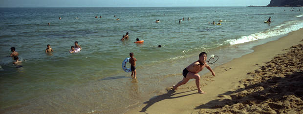 In this Aug. 11, 2012 photo, a North Korean plays badminton at Majon Beach near Hamhung, North Korea. (AP Photo/David Guttenfelder)