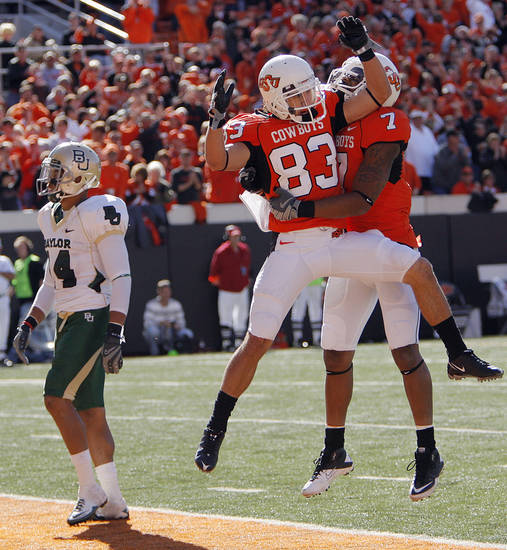 Oklahoma State's Colton Chelf (83) and Michael Harrison (7) celebrate Chelf's touchdown in front of Baylor's Byron Landor (14) during the college football game between the Oklahoma State University Cowboys (OSU) and the Baylor University Bears at Boone Pickens Stadium in Stillwater, Okla., Saturday, Nov. 6, 2010. Photo by Chris Landsberger, The Oklahoman