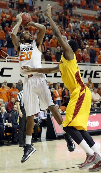 Oklahoma State Cowboys&#039; Michael Cobbins (20) shoots over Iowa State Cyclones&#039; Tyler Ellerman (33) during the college basketball game between the Oklahoma State University Cowboys (OSU) and the Iowa State University Cyclones (ISU) at Gallagher-Iba Arena on Wednesday, Jan. 30, 2013, in Stillwater, Okla.  Photo by Chris Landsberger, The Oklahoman
