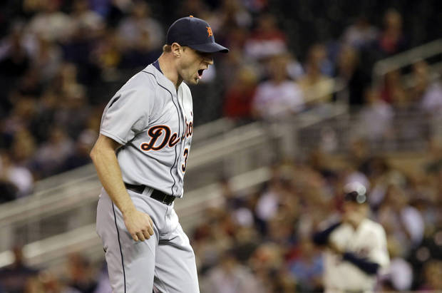 Detroit Tigers pitcher Max Scherzer reacts after he struck out Minnesota Twins' Josmil Pinto to end the first inning of a baseball game, Wednesday, Sept. 25, 2013, in Minneapolis. (AP Photo/Jim Mone)