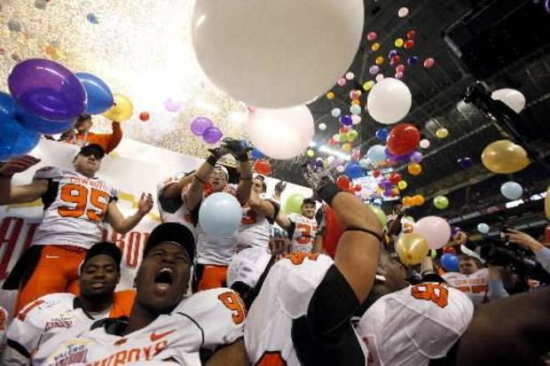Oklahoma State celebrates their win over Arizona in the Valero Alamo Bowl at the Alamodome in San Antonio, Texas, Wednesday, December 29, 2010. OSU won, 36-10. Photo by Sarah Phipps