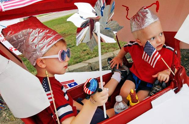 Trent Nondorf, 4, left, and Ethan Nondorf, 2, wait for the start of the Quail Creek Fourth of July parade in Oklahoma City, Saturday, July 4, 2009. Photo by Nate Billings, The Oklahoman