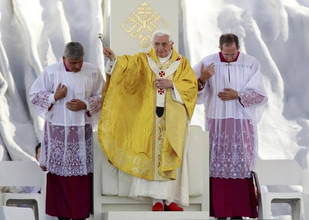 Pope Benedict XVI, center, celebrates mass at the Cuatro Vientos airbase outside Madrid, Sunday, Aug. 21, 2011. The Pope arrived in Madrid Thursday for a four-day visit to celebrate the church's World Youth Day. (AP Photo/Armando Franca)