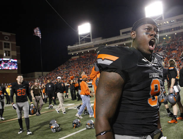 Oklahoma State's Kye Staley (9) celebrates the Cowboys' win over Kansas State during a college football game between the Oklahoma State University Cowboys (OSU) and the Kansas State University Wildcats (KSU) at Boone Pickens Stadium in Stillwater, Okla., Saturday, Nov. 5, 2011.  Photo by Sarah Phipps, The Oklahoman