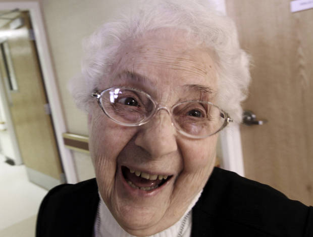In this April 10, 2012, photo, sister Annette Bouchard, 94, smiles into the camera at St. Joseph Convent in Biddeford, Maine. Good Shepherd Sisters of Quebec has just six convents in Maine and Massachusetts with fewer than 60 sisters. The youngest is 64, and it�s been more than 20 years since a new member has joined. Sister Elaine Lachance is using the Internet, social media and even a blog to attract women who feel the calling to serve God. (AP Photo/Pat Wellenbach)