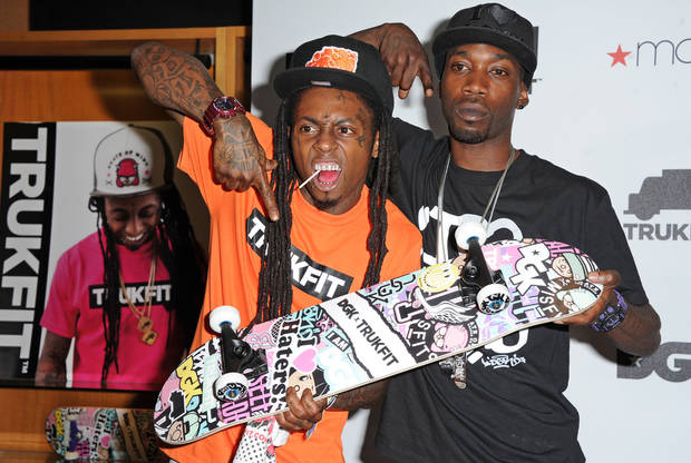 This June 1, 2012 file photo shows Grammy Award winning hip hop artist Lil Wayne, left, and professional skateboarder Stevie Williams celebrating at the launch of their contemporary clothing lines TRUKFIT and DGK at Macy�s stores in Los Angeles. (Photo by Katy Winn/Invision, file)