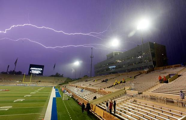 Lightning streaks across the sky during a weather delay before a college football game between the Oklahoma State University Cowboys (OSU) and the University of Tulsa Golden Hurricane (TU) at H.A. Chapman Stadium in Tulsa, Okla., Saturday, Sept. 17, 2011. Photo by Nate Billings, The Oklahoman