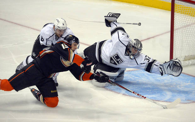 Anaheim Ducks center Nick Bonino, second from left, scores on Los Angeles Kings goalie Jonathan Quick, right, as defenseman Jake Muzzin reaches in during the first period of their NHL hockey game, Saturday, Feb. 2, 2013, in Anaheim, Calif. (AP Photo/Mark J. Terrill)