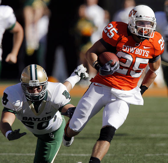 Oklahoma State's Josh Cooper (25) returns a kick past Baylor's Jerod Monk (20) during the college football game between the Oklahoma State University Cowboys (OSU) and the Baylor University Bears at Boone Pickens Stadium in Stillwater, Okla., Saturday, Nov. 6, 2010. Photo by Chris Landsberger, The Oklahoman