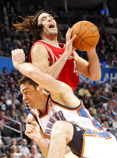 Oklahoma City's Nick Collison collides with Houston's Luis Scola during their NBA basketball game at the OKC Arena in downtown Oklahoma City on Wednesday, Nov. 17, 2010. Photo by John Clanton, The Oklahoman