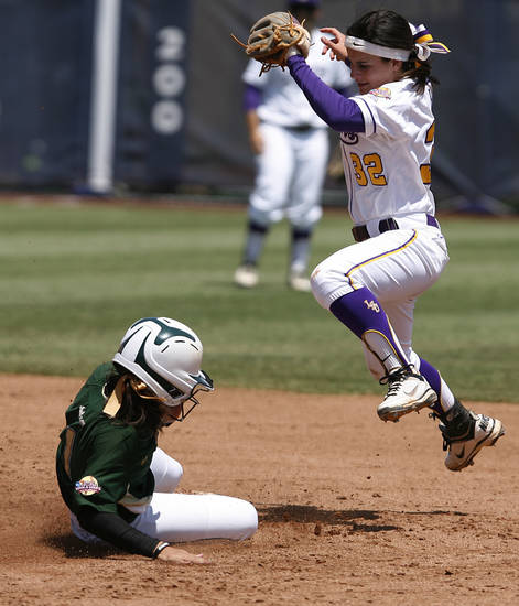 USF's Courtney Goff (1) slides into second base past LSU's Allison Falcon (32) during a Women's College World Series game between Louisiana State University and the University of South Florida at ASA Hall of Fame Stadium in Oklahoma City, Saturday, June 2, 2012.  Photo by Garett Fisbeck, The Oklahoman