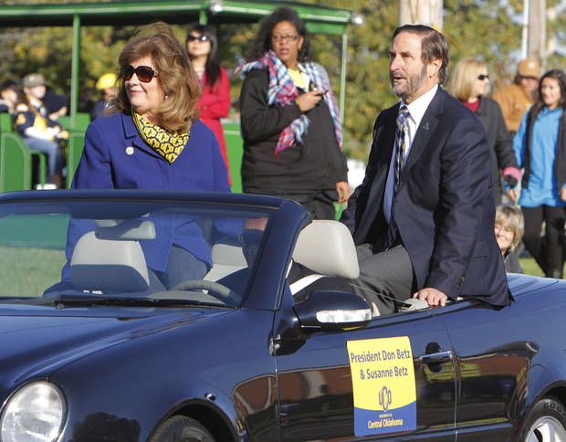 UCO President Don Bets and his wife Susanne wave to crowds during the University of Central Oklahoma's homecoming parade in Edmond, OK, Saturday, November 3, 2012,  By Paul Hellstern, The Oklahoman