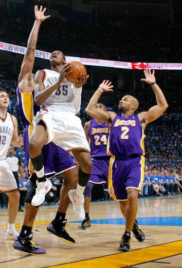 Oklahoma City's Kevin Durant goes past Kobe Bryant, center, and Derek Fisher of Los Angeles during the basketball game between the Los Angeles Lakers and the Oklahoma City Thunder in the first round of the NBA playoffs at the Ford Center in Oklahoma City, Thursday, April 22, 2010. Photo by Nate Billings, The Oklahoman