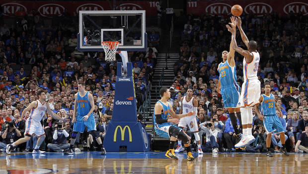 Oklahoma City Thunder's Kevin Durant (35) shoots a three over New Orleans Hornets' Anthony Davis (23) during the NBA basketball game between the Oklahoma CIty Thunder and the New Orleans Hornets at the Chesapeake Energy Arena on Wednesday, Dec. 12, 2012, in Oklahoma City, Okla.   Photo by Chris Landsberger, The Oklahoman