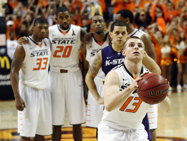 Oklahoma State's Marcus Smart (33), Michael Cobbins (20),  Markel Brown (22),  Brian Williams (4) and Kansas State's Angel Rodriguez watch as Oklahoma State's  Phil Forte (13) takes a free throw in the second half of an NCAA college basketball game in Stillwater, Okla., Saturday, March 9, 2013. Oklahoma State won 76-70. (AP Photo/Sue Ogrocki) ORG XMIT: OKSO108
