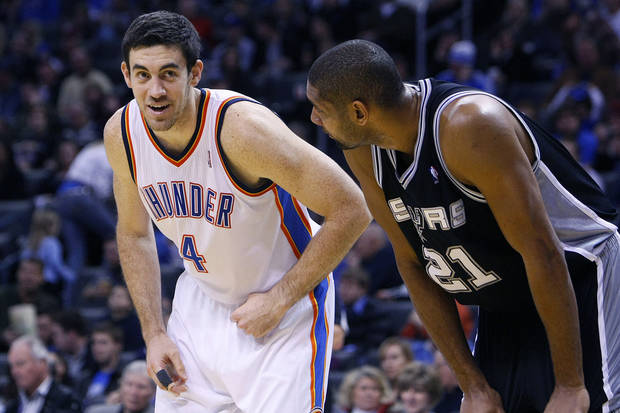 Oklahoma City's Nick Collison, left, standing with San Antonio's Tim Duncan. PHOTO BY HUGH SCOTT, THE OKLAHOMAN