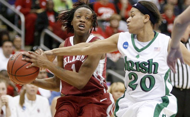 OU's Nyeshia Stevenson tries to pass the ball around Notre Dame's Ashley Barlow during the Sweet 16 round of the NCAA women's  basketball tournament in Kansas City, Mo., on Sunday, March 28, 2010. 
