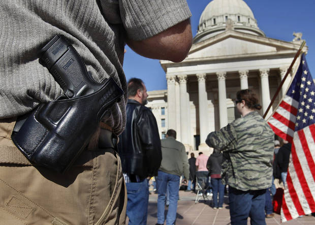 David Bradley of Moore, Okla., wears a pistol on his belt at the rally. He applied for his permit about two years ago. Organizers said an estimated 1800 people from throughout Oklahoma crowded into the south plaza at the state Capitol Saturday afternoon, Jan. 19, 2013, to voice their support for their second amendment rights and to express  concerns about proposed gun control legislation being considered by the federal government in the wake of the school shooting in Connecticut last month. Many  held aloft hand-made signs or waved American flags as speakers addressed the gun rights rally. Oklahoma passed an open carry law that recently took effect allowing citizens to openly carry a holstered weapon on their body if they have been granted a license.  Photo by Jim Beckel, The Oklahoman