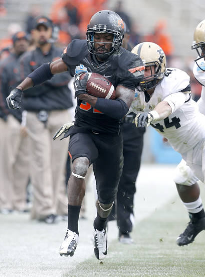 Oklahoma State's Isaiah Anderson (82) gets past Purdue's Landon Feichter (44) during the Heart of Dallas Bowl football game between the Oklahoma State University (OSU) and Purdue University at the Cotton Bowl in Dallas,  Tuesday,Jan. 1, 2013. Photo by Sarah Phipps, The Oklahoman