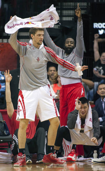 Houston Rockets' Chandler Parsons, left, James Harden, center, and Jeremy Lin, right, react to a 3-point shot during the fourth quarter of an NBA basketball game against the Golden State Warriors, Tuesday, Feb. 5, 2013, in Houston. The Rockets tied an NBA record and set a franchise mark with 23 3-pointers in a 140-109 win over Golden State. (AP Photo/Dave Einsel)