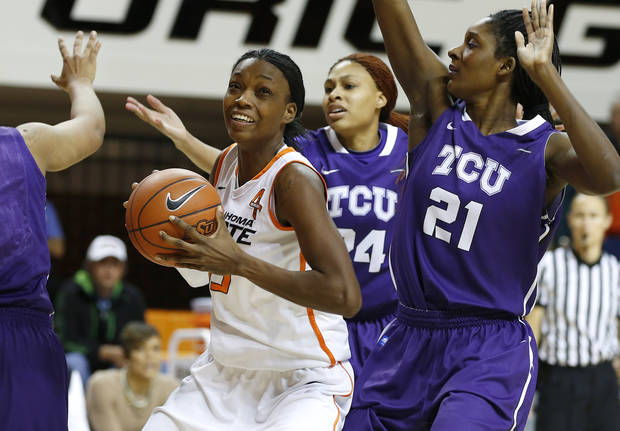 Oklahoma State's Toni Young (15) goes to the basket past TCU's Natalie Ventress (24) and Latricia Lovings (21) during a women's college basketball game between Oklahoma State University and TCU at Gallagher-Iba Arena in Stillwater, Okla., Tuesday, Feb. 5, 2013. Photo by Bryan Terry, The Oklahoman