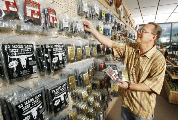 Store owner Mark Garvey at The Beef Jerky Emporium in Oklahoma City Thursday, Dec. 21, 2006, with a wall of dozens of different types of jerky. BY PAUL B. SOUTHERLAND, The Oklahoman ORG XMIT: KOD