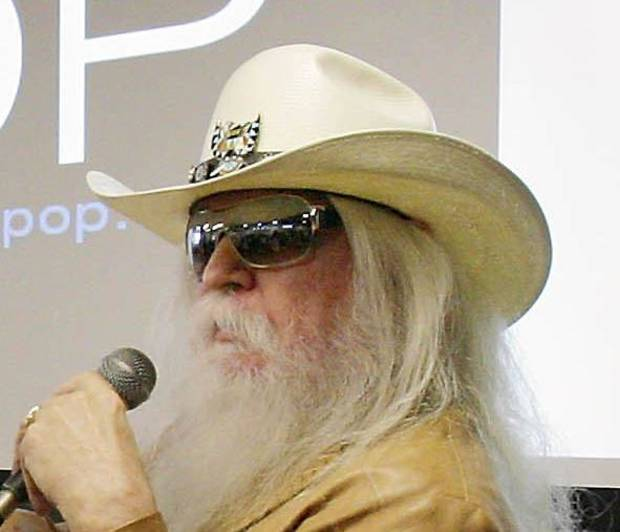 Music icon Leon Russell, right, talks Tuesday during an announcement that a  compilation of his archive and memorabilia will be housed at the Oklahoma  Museum of Popular Culture. Photo by MICHAEL WYKE, Tulsa World