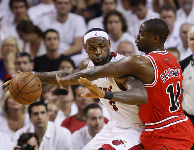 Miami Heat's LeBron James, left, drives up against Chicago Bulls' Ronnie Brewer during the first half of Game 4 of the NBA Eastern Conference finals basketball series in Miami, Tuesday, May 24, 2011. (AP Photo/Wilfredo Lee) ORG XMIT: AAA115