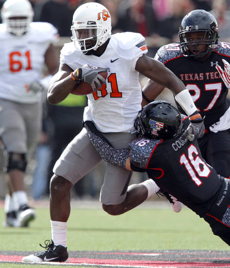 Oklahoma State&#039;s Justin Blackmon (81) tries to get by Texas Tech&#039;s Cody Davis (16) during a college football game between Texas Tech University (TTU) and Oklahoma State University (OSU) at Jones AT&amp;T Stadium in Lubbock, Texas, Saturday, Nov. 12, 2011.  Photo by Sarah Phipps, The Oklahoman  ORG XMIT: KOD
