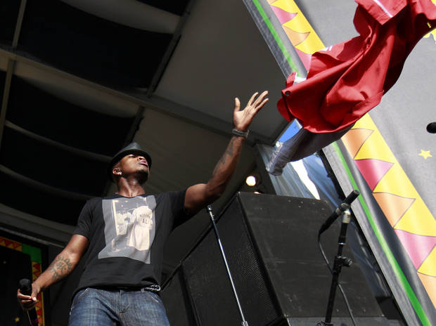 Ne-Yo tosses his jacket to the crowd as he performs at the New Orleans Jazz and Heritage Festival in New Orleans, Saturday, May 5, 2012. (AP Photo/Gerald Herbert)