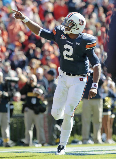 Auburn quarterback Cameron Newton (2) reacts after he scored on a 1-yard run against Chattanooga in the first half of an NCAA college football game Saturday, Nov. 6, 2010 at Jordan-Hare Stadium in Auburn, Ala. (AP Photo/Dave Martin) ORG XMIT: ALDM107