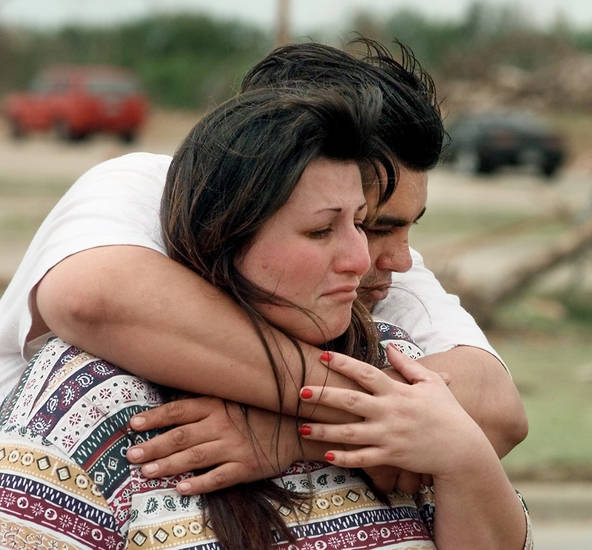MAY 3, 1999 TORNADO: Tornado victims, damage: Pollyann and Pedro Mendoza look at their home demolished during Monday night's tornado in Moore.
