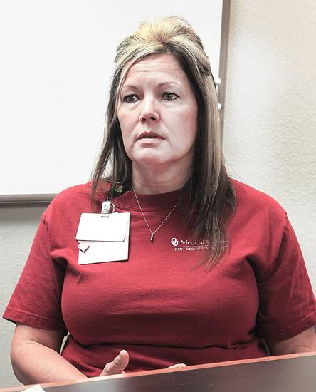Dana Klingenburg, a nurse at OU Medical Center, discusses her daughter�s recent black widow spider bite.  Photo by David McDaniel, The Oklahoman