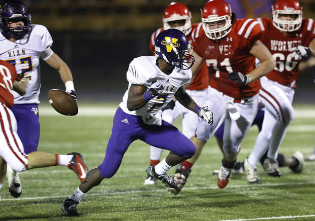 Vian runningback  Eric Casey was making a big run and being pursued by Davis tacklers when the football suddenly popped out of his hands and fell to the turf behind him. It was recovered by Davis players. Vian Wolverines play Davis Wolves in the Class 2A semifinal game Friday night, Friday, Nov. 30, 2012, at Rose Field, Jim Darnell Stadium in Midwest City.  Photo by Jim Beckel, The Oklahoman