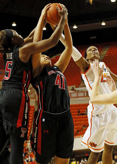 Oklahoma State&#039;s Toni Young (15) battles for a rebound with Texas Tech&#039;s Christine Hyde (5) and Kelsi Baker (41) during a women&#039;s college basketball game between Oklahoma State University (OSU) and Texas Tech at Gallagher-Iba Arena in Stillwater, Okla., Wednesday, Jan. 2, 2013. Texas Tech won, 64-59.  Photo by Nate Billings, The Oklahoman