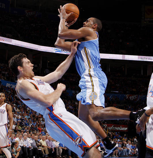 Oklahoma City's Nick Collison, left, is called for a foul againt Denver's Arron Afflalo during the NBA basketball game between the Oklahoma City Thunder and the Denver Nuggets at Chesapeake Energy Arena in Oklahoma City, Wednesday, April 25, 2012. Oklahoma City lost 106-101. Photo by Bryan Terry, The Oklahoman