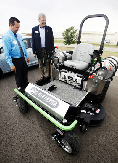 Norman Fleet Superintendent Mike White, left, and City Manager Steve Lewis examine the city's latest compressed natural gas acquisition, a cng-powered industrial lawn mower. PHOTO BY PAUL B. Southerland, THE OKLAHOMAN <strong>PAUL B. SOUTHERLAND</strong>
