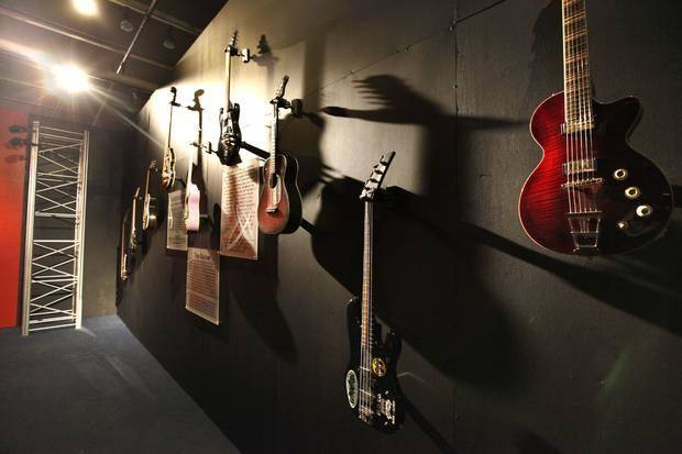 "A collection of guitars adorns a wall of the new traveling exhibit ""The Science of Rock 'n' Roll"" at Science Museum Oklahoma. Photo by Paul Hellstern, The Oklahoman"