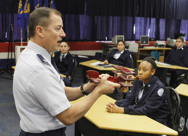 Air Force Lt. Col. Mike Penning discusses the science of aeronautics during class time for the Midwest City High School JROTC.