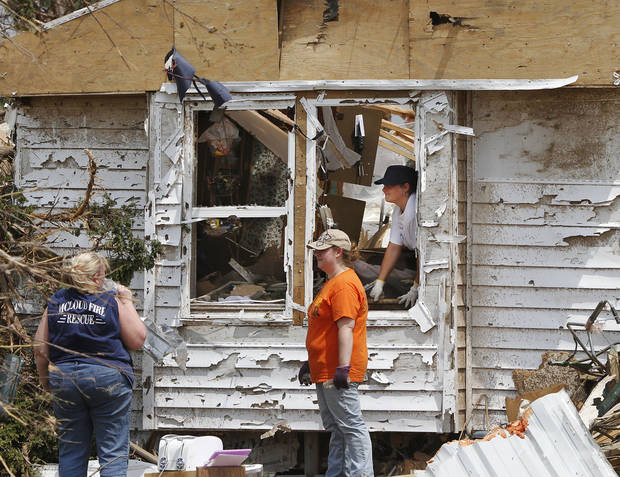 Residents of Steelman Estates in Bethel Acres sift through the remains of their homes on Monday, May 20, 2013, after a violent tornado ripped through the neighborhood yesterday, killing one man.    Photo  by Jim Beckel, The Oklahoman.