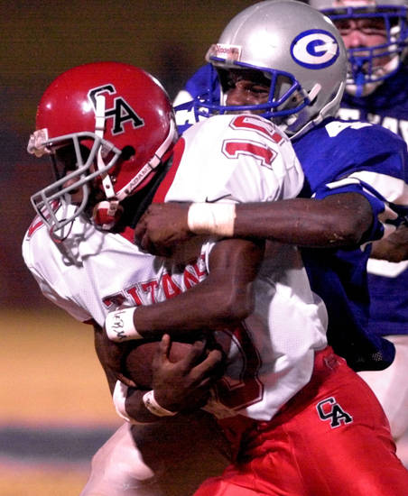 Guthrie's Demarko Jones, left, brings down Carl Albert's Herman Burge in the Bluejays' win on Oct. 19, 2001. PHOTO BY BRYAN TERRY, THE OKLAHOMAN ARCHIVE