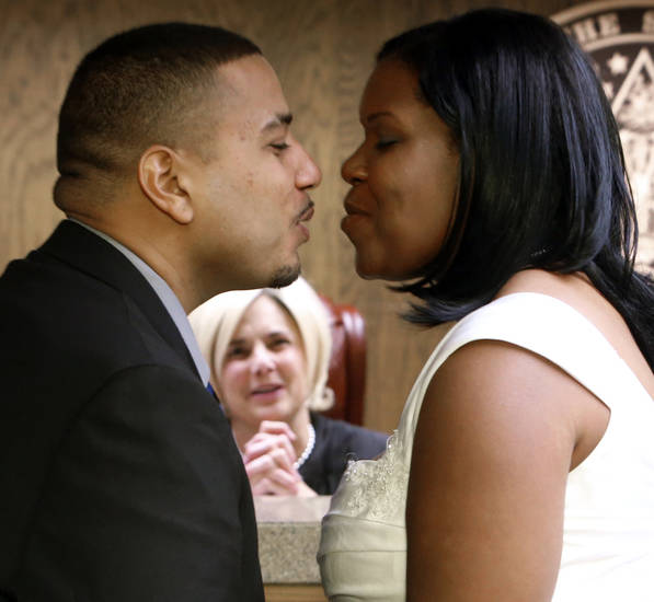 DECEMBER / DEC. 12, 2012: Daniel Reed marries Marquita Ware, both of Wichita, Kansas, in Cleveland County judge Jequita Napoli&#039;s courtroom as she performs multiple marriage ceremonies for couples who like the date 12/12/12 at the courthouse on Wednesday, Dec. 12, 2012, in Norman, Okla.  Photo by Steve Sisney, The Oklahoman