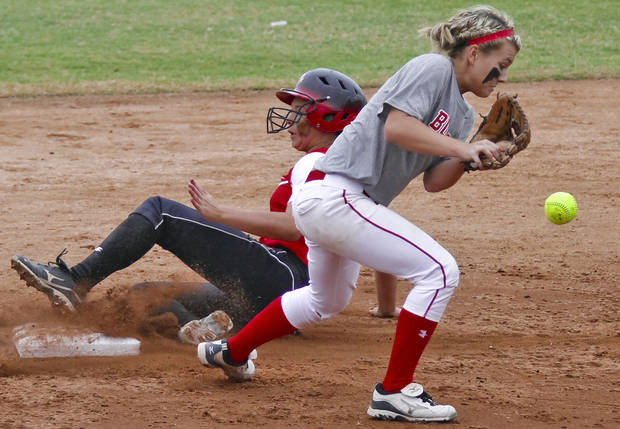HIGH SCHOOL SOFTBALL TOURNAMENT: Washington's Cierra Logan (8) slides into second as Sulphur's Harlee Griffis (13) drops the ball during the Oklahoma State Softball tournament game between Washington and Sulphur at ASA Hall of Fame Stadium on Thursday, Oct. 4, 2012, in Oklahoma City, Okla.   Photo by Chris Landsberger, The Oklahoman