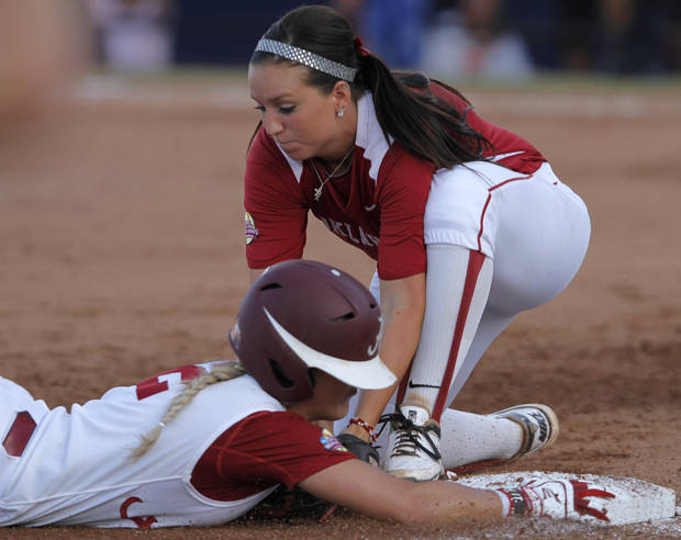 Oklahoma's Brianna Turang (2) is tagged by Alabama's Danae Hays (15) during a Women's College World Series game between OU and Alabama at ASA Hall of Fame Stadium in Oklahoma City, Monday, June 4, 2012.  Photo by Garett Fisbeck, The Oklahoman