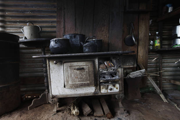 "In this Nov. 14, 2012 photo, the stove of Isabel Iglesias stands in her kitchen at her home in the Yvy Pyta settlement near Curuguaty, Paraguay.  Iglesias's husband Avelino Espinola was killed during the ""Massacre of Curuguaty"" on June 15 when negotiations between farmers occupying a rich politician's land ended with a barrage of bullets that killed 11 farmers and 6 police officers. (AP Photo/Jorge Saenz)"