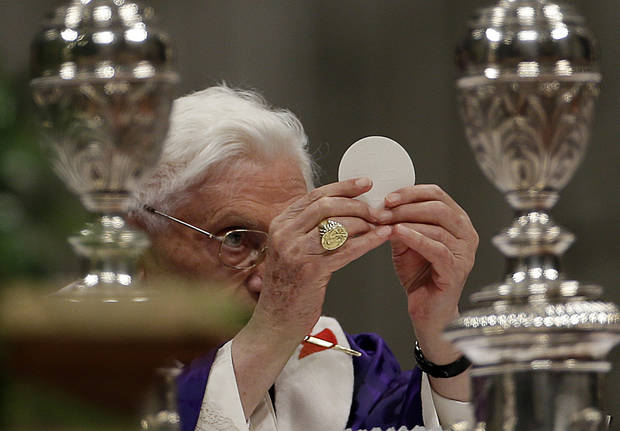 "Pope Benedict XVI holds up the host as he celebrates the Ash Wednesday mass in St. Peter's Basilica at the Vatican, Wednesday, Feb. 13, 2013.  Ash Wednesday marks the beginning of Lent, a solemn period of 40 days of prayer and self-denial leading up to Easter. Pope Benedict XVI told thousands of faithful Wednesday that he was resigning for ""the good of the church"", an extraordinary scene of a pope explaining himself to his flock that unfolded in his first appearance since dropping the bombshell announcement. (AP Photo/Gregorio Borgia)"