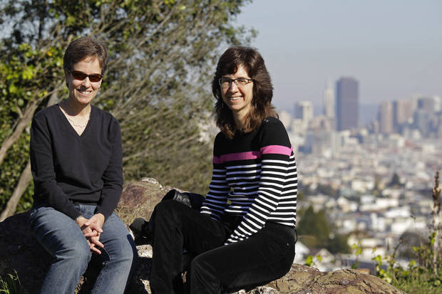 In this photo taken Monday, Nov. 12, 2012, Amy Cunninghis, left, and Karen Golinski, pose at a park by their home in San Francisco. All Golinski wanted was to enroll her spouse in her employer-sponsored health plan. Four years later, her request still is being debated. Because Golinski is married to another woman and she works for the federal government, her personal personnel problem has morphed into a multi-pronged legal attack by gay rights activists to overturn the 1996 law that defines marriage as the union of a man and a woman. (AP Photo/Eric Risberg)