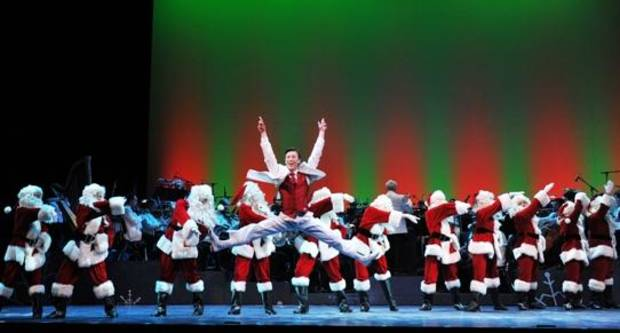 "Cory Lingner performs as the featured dancer during the ""Santa Claus Is Tappin' To Town"" number during the Oklahoma City Philharmonic's ""The Christmas Show"" in 2012. An audience favorite, the musical number returns as part of this year's production. Photo by Wendy Mutz"